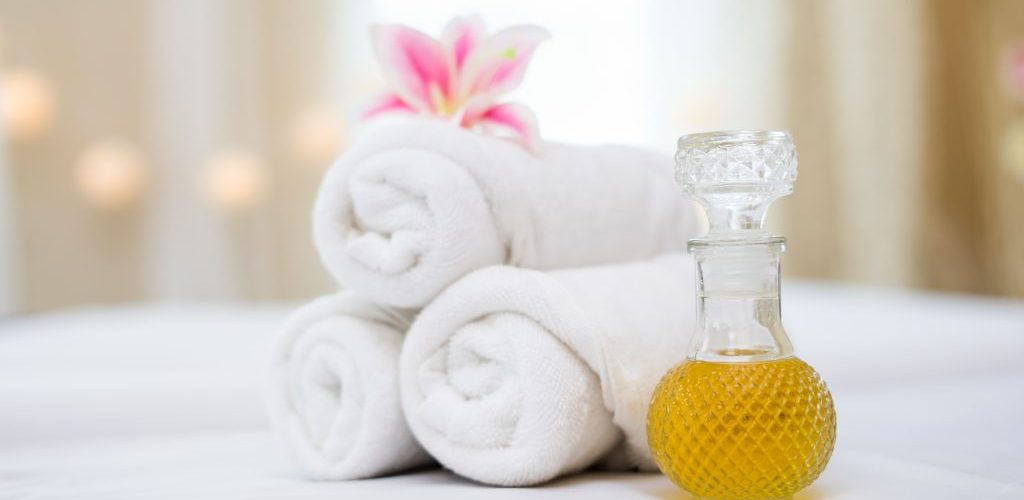 Towel with spa oil for spa setting
